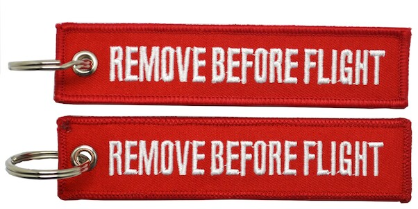 Keyholder with  REMOVE BEFORE FLIGHT on both sides, red background  KEY-RBF